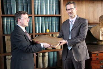 Richard Heaton presents Giles Mandelbrote with a rare Book of Common Prayer
