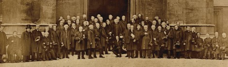 Bishops attending the 1867 conference, outside Lambeth Palace. Archbishop Longley is standing in the centre, with Robert Gray, Bishop of Cape Town, sitting on the step below him (ref: Longley 9, f2)